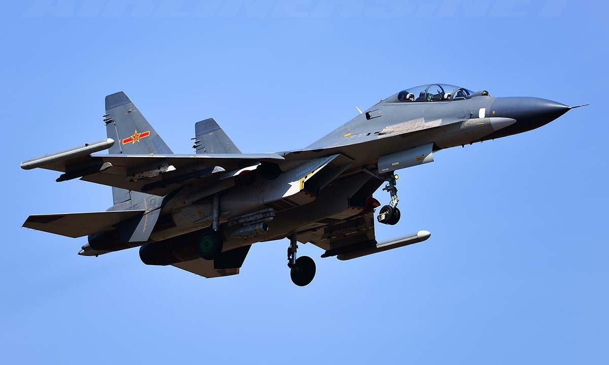 Tiêm kích Su-30 Trung Quốc bay huấn luyện năm 2014. Ảnh: Airliners.