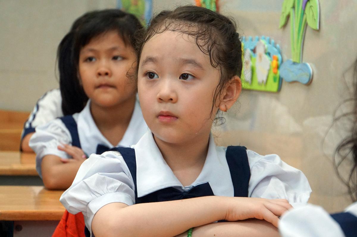 Học sinh lớp 1 trường tiểu học Mê Linh (quận 3, TP HCM) trong một buổi học tháng 5/2020. Ảnh: Mạnh Tùng.