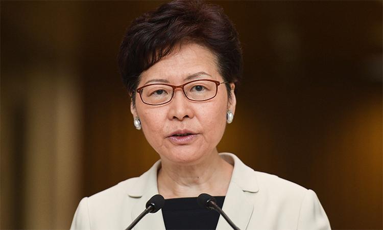 Trưởng đặc khu hành chính Hong Kong Carrie Lam trong một buổi họp báo, tháng 12/2019. Ảnh: AFP.