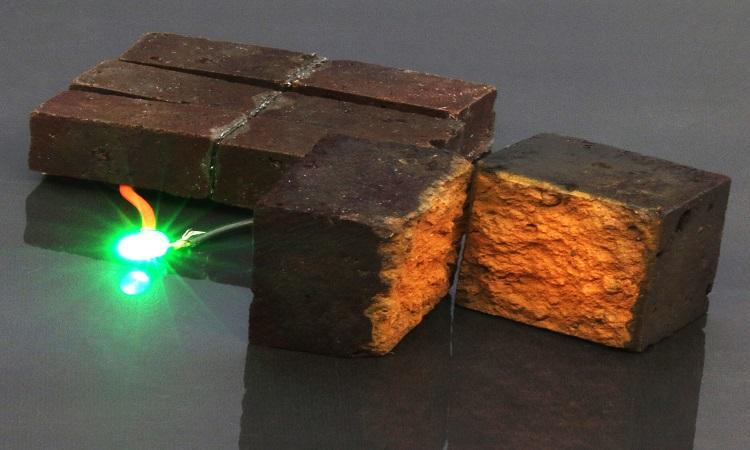 Các nhà nghiên cứu sử dụng gạch thông minh để thắp sáng bóng đèn LED. Ảnh: Phys.org.
