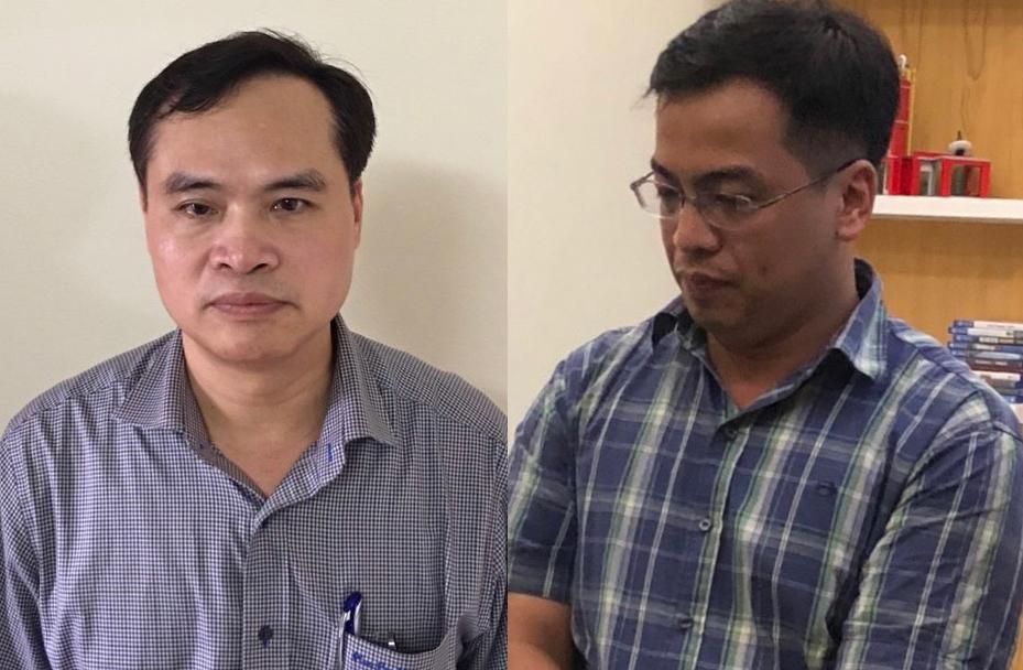 Ông Nguyễn Chí Thành (trái) và Lê Trung Cường tại cơ quan công an. Ảnh: Bộ Công an