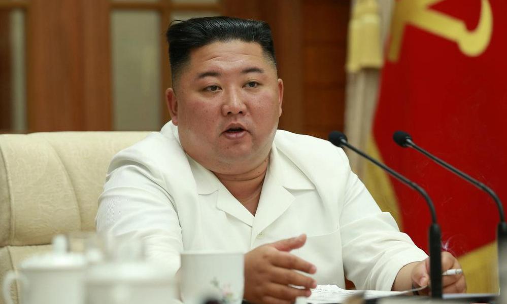 Kim Jong-un chủ trì cuộc họp trong bức ảnh được Triều Tiên công bố ngày 25/8. Ảnh: KCNA.