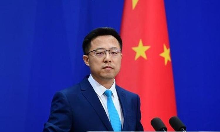 Phát ngôn viên Bộ Ngoại giao Trung Quốc Triệu Lập Kiên tại buổi họp báo tại Bắc Kinh, ngày 9/4. Ảnh: China News.