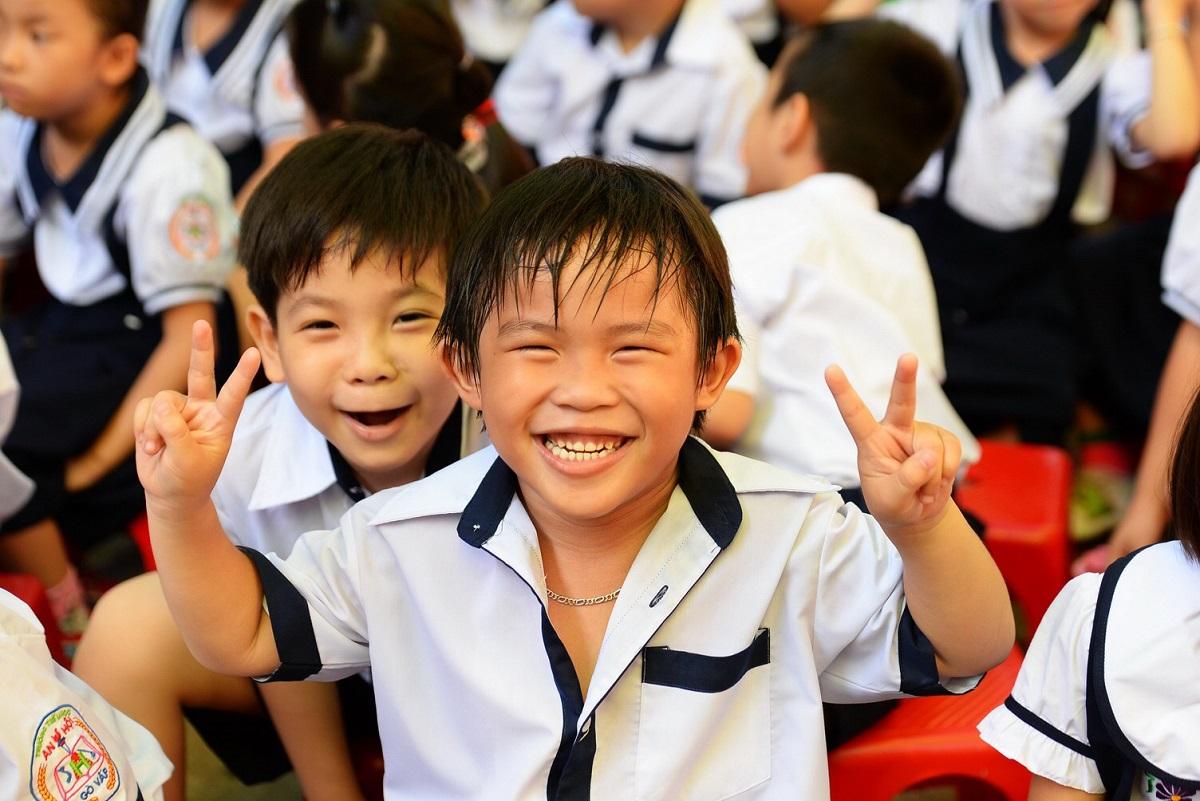 Học sinh tiểu học ở TP HCM. Ảnh: Hữu Khoa.