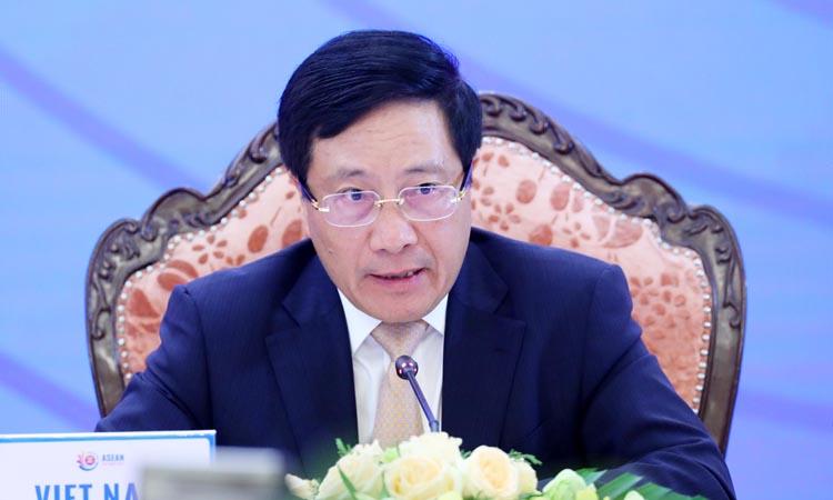 Phó Thủ tướng, Bộ trưởng Ngoại giao Phạm Bình Minh chủ trì Hội nghị Bộ trưởng Ngoại giao Cấp cao Đông Á (EAS) lần thứ 10 hôm 9/9. Ảnh: TTXVN.