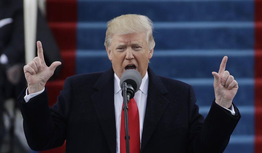 Trump phát biểu sau khi tuyên thệ nhậm chức tổng thống tại thủ đô Washington vào ngày 20/1/2017. Ảnh: AP.