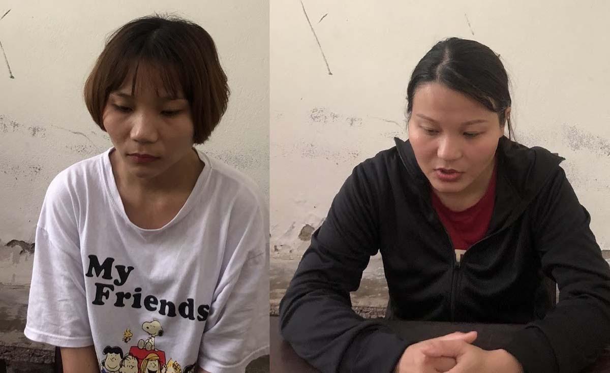 Uông Thị Trang (áo đen) cùng em gái tại cơ quan điều tra. Ảnh: Công an cung cấp.