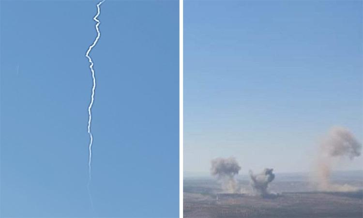 Vệt khói trên có thể là của tên lửa Iskander-M (trái) và khói bốc lên từ vị trí bị tấn công (phải) ở tỉnh idlib, Syria. Ảnh: Twitter/Mahmoud Mosa.
