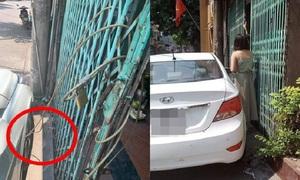 Chủ nhà xích ôtô vào cửa vì bị đỗ chắn lối đi