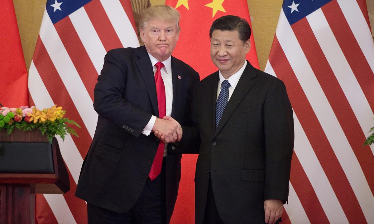 Tổng thống Donald Trump (trái) và Chủ tịch Trung Quốc Tập Cận Bình tại Bắc Kinh hồi tháng 11/2017. Ảnh: AFP.