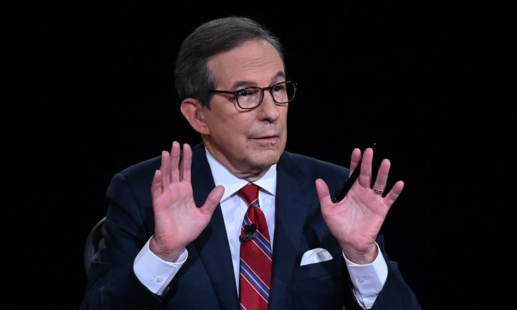 Người điều hành Chris Wallace tại cuộc tranh luận tổng thống đầu tiên ở Cleveland, Ohio, hôm 29/9. Ảnh: AP.