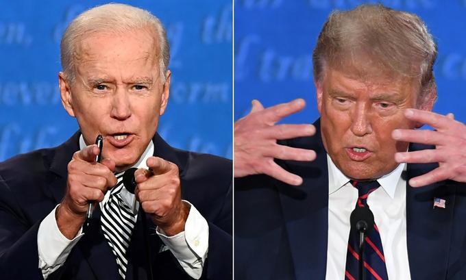 Tổng thống Trump (phải) và ứng viên đảng Dân chủ Joe Biden trong cuộc tranh luận ở Ohio ngày 29/9, Ảnh: AFP.