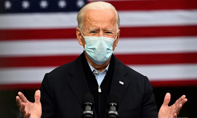Ứng viên tổng thống đảng Dân chủ Joe Biden tại sự kiện vận động tranh cử ở bang Michigan hôm 2/10. Ảnh: AFP.