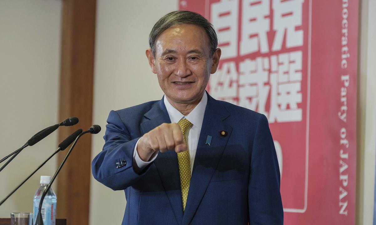 Thủ tướng Nhật Bản Yoshihide Suga trong buổi họp báo ở Tokyo hôm 14/9. Ảnh: AP.