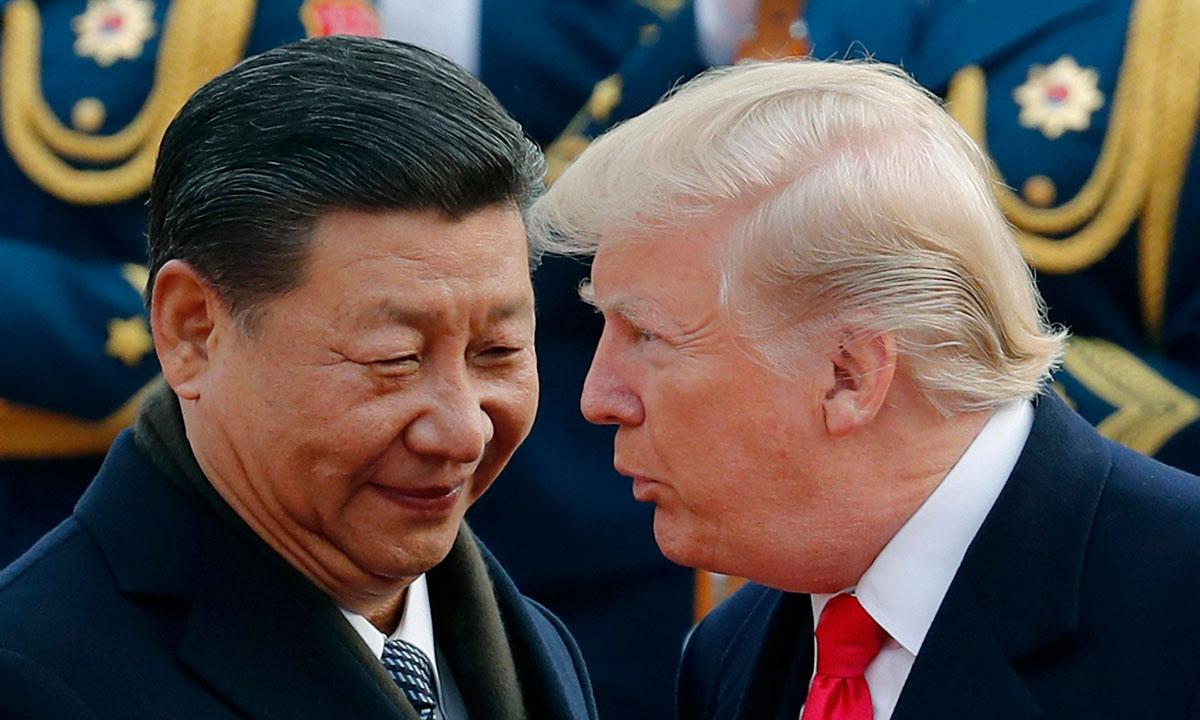 Tổng thống Donald Trump (phải) và Chủ tịch Tập Cận Bình tại Bắc Kinh năm 2017. Ảnh: AP.