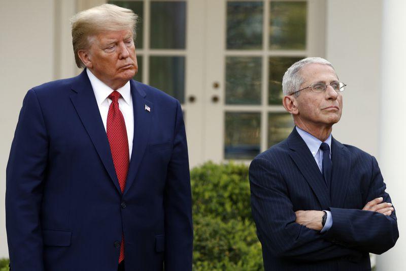 Tổng thống Mỹ Donald Trump và Tiến sĩ Anthony Fauci tại cuộc họp với lực lượng chuyên trách chống Covid-19 của Nhà Trắng ở Vườn Hồng, Nhà Trắng, ngày 29/3. Ảnh: AP.