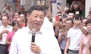 Người Trung Quốc đổ ra đường chụp ảnh ông Tập