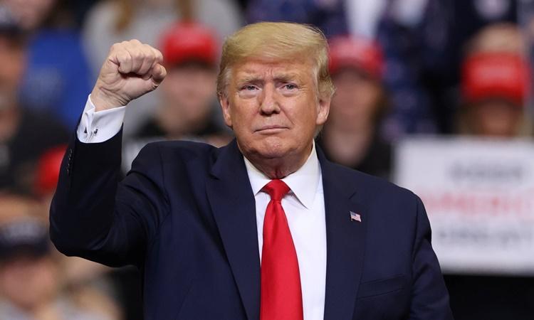 Tổng thống Donald Trump tại một buổi vận động tranh cử ở Iowa hồi tháng một. Ảnh: Reuters.