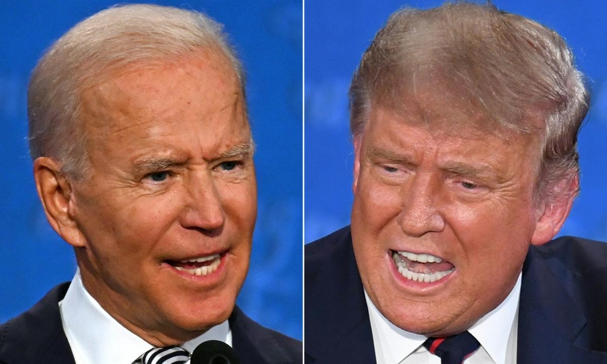 Tổng thống Mỹ Trump (phải) và ứng viên đảng Dân chủ Joe Biden tại cuộc tranh luận đầu tiên ở Ohio ngày 29/9. Ảnh: AFP.