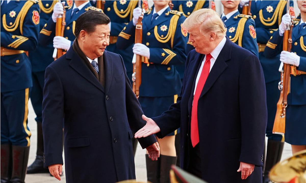 Tổng thống Donald Trump (phải) và Chủ tịch Tập Cận Bình tại Bắc Kinh hồi tháng 11/2017. Ảnh: Tass.