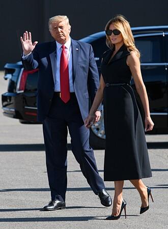 Vợ chồng Trump đến sân bay quốc tế Nashville, bang Tennessee hôm 22/10. Ảnh: AFP.
