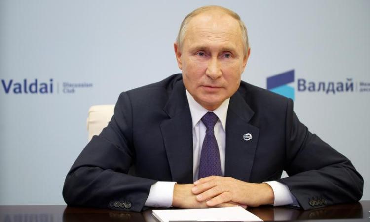 Tổng thống Nga Vladimir Putin phát biểu trong một cuộc họp trực tuyến hôm 22/10. Ảnh: Reuters.
