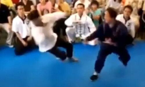 Võ sư truyền điện Trung Quốc no đòn khi thách đấu võ sĩ MMA  - 1