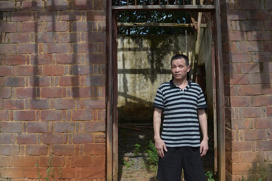 Ông Trương Ngọc Hoàn thăm lại nhà cũ vào tháng 8. Ảnh: CFP.