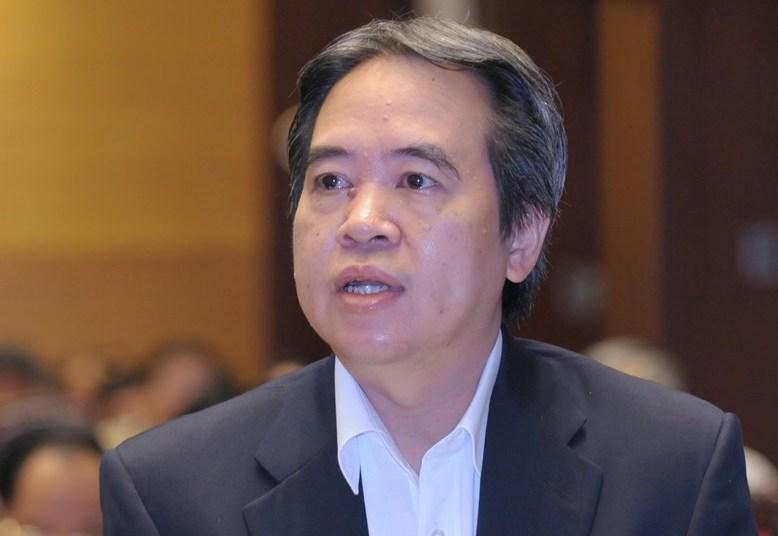 Ông Nguyễn Văn Bình trong một lần trả lời chất vấn của Quốc hội trên vai trò Thống đốc Ngân hàng Nhà nước, tháng 11/2013. Ảnh: Hoàng Phong