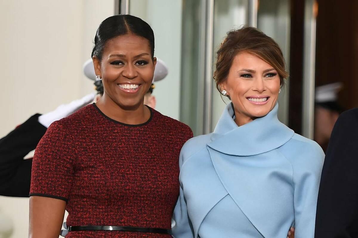 Michelle Obama chào đón Melania Trump đến Nhà Trắng ngày 20/1/2017. Ảnh: AFP.
