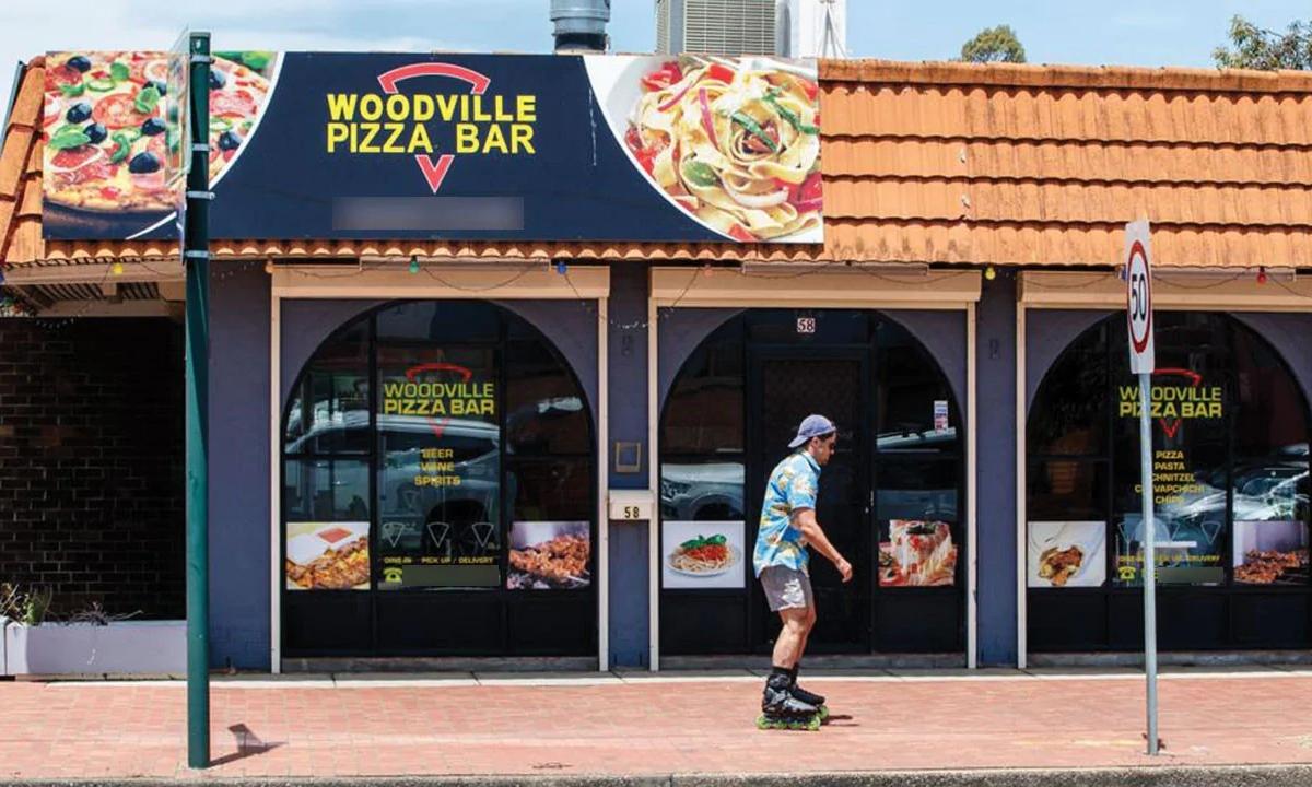 Quán Woodville Pizza Bar, điểm nóng Covid-19 tại thành phố Adelaide. Ảnh: Matt Turner