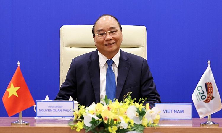 Thủ tướng Nguyễn Xuân Phúc tham dự Hội nghị thượng đỉnh G20 trực tuyến ngày 21/11 từ Hà Nội. Ảnh: TTXVN.