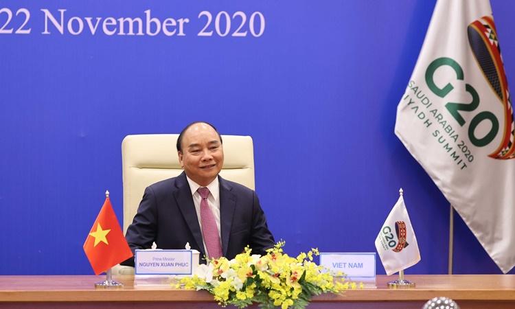 Thủ tướng Nguyễn Xuân Phúc tham dự Hội nghị thượng đỉnh G20 trực tuyến ngày 22/11 từ Hà Nội. Ảnh: Bộ Ngoại giao.