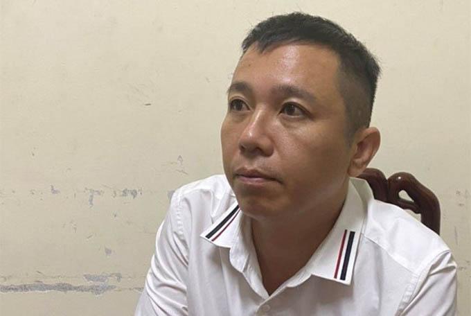 Nguyễn Duy Tuấn tại cơ quan điều tra. Ảnh: CA.