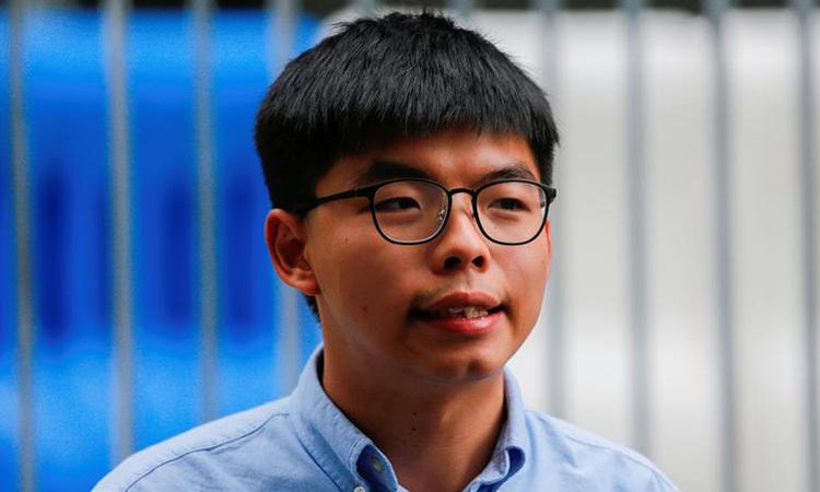 Joshua Wong trả lời phóng viên hồi tháng 10/2019. Ảnh: Reuters.