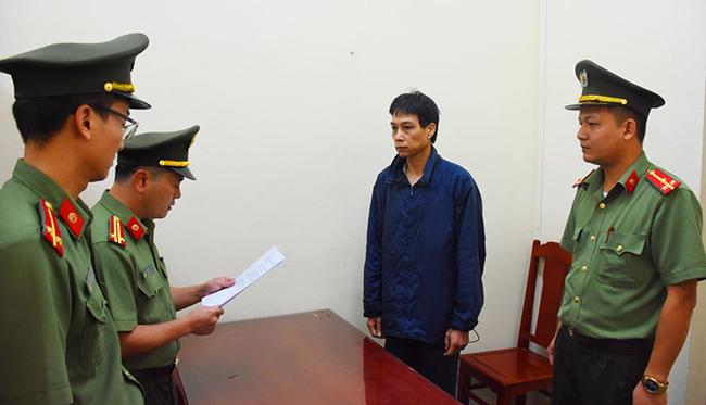 Bị can Vi Du Lịch khi bị bắt giam. Ảnh: Lam Sơn.