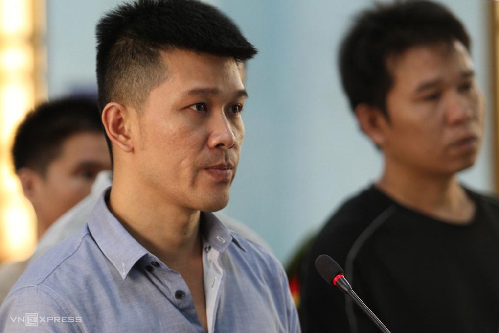 Nguyễn Mạnh Hùng bị đưa ra xét xử hồi tháng 5. Ảnh: Trần Hoá.