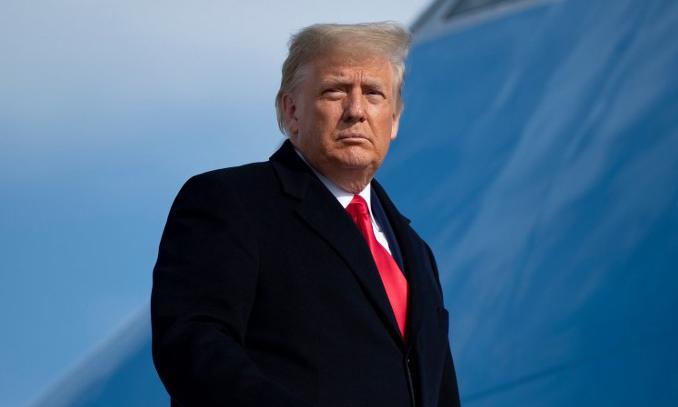 Tổng thống Mỹ Donald Trump tại sân bay căn cứ không quân Andrews, bang Maryland, hôm 12/12. Ảnh: AFP.