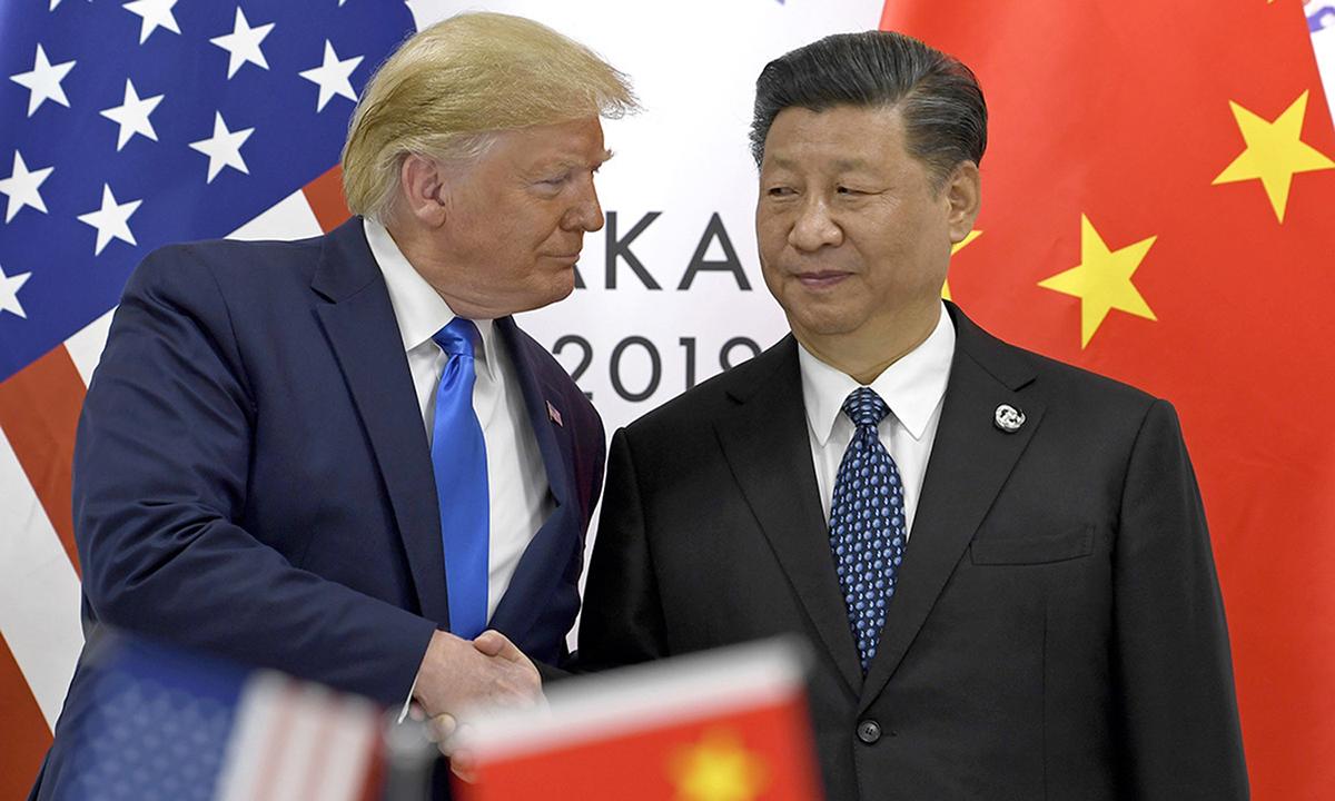 Tổng thống Donald Trump (trái) và Chủ tịch Tập Cận Bình tại hội nghị G20 ở Osaka, Nhật Bản năm 2019. Ảnh: AP.