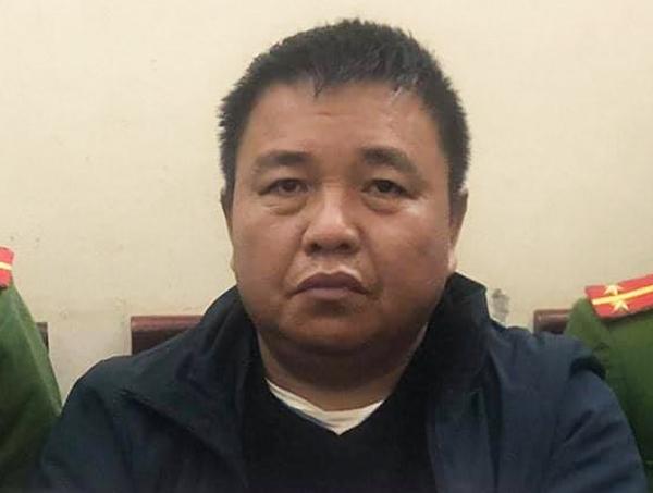 Trần Văn Minh tại cơ quan công an.