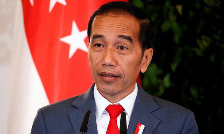 Tổng thống Indonesia Joko Widodo phát biểu trong chuyến thăm Singapore năm ngoái. Ảnh: Reuters.