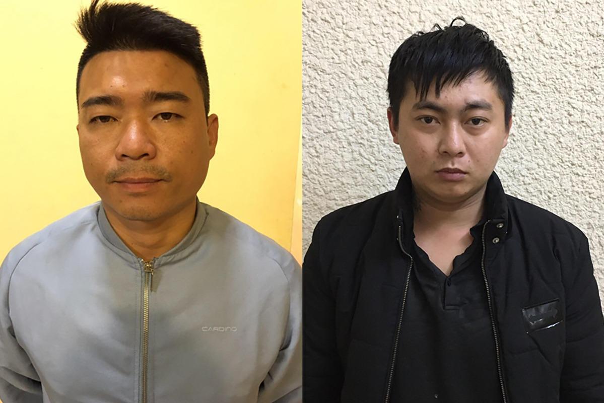 Giang (trái) và Toại tại cơ quan điều tra. Ảnh: Xuân Dũng.