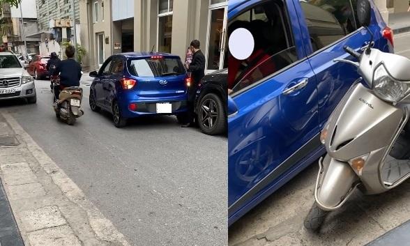 Nữ tài xế gặp khó khăn khi lùi xe vào chỗ đỗ dù đã có nhân viên chỉ dẫn.