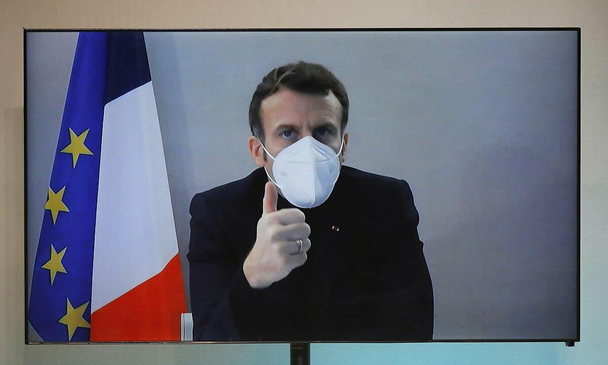 Tổng thống Pháp Macron tham dự từ xa Hội nghị Nhân đạo Quốc gia ở Pháp ngày 17/12. Ảnh: AFP.