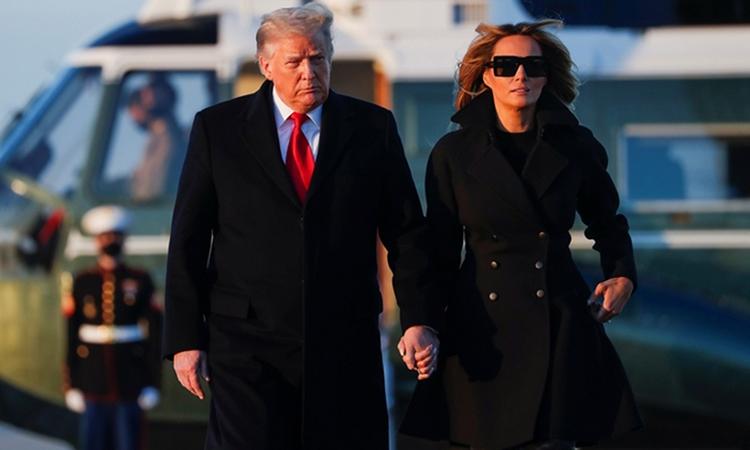 Tổng thống Trump và Đệ nhất phu nhân Melania khởi hành tới Florida hôm 23/12. Ảnh: AFP.