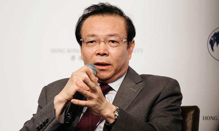 Lưu Tiểu Dân trong một lần trả lời báo chí năm 2016. Ảnh: Bloomberg.
