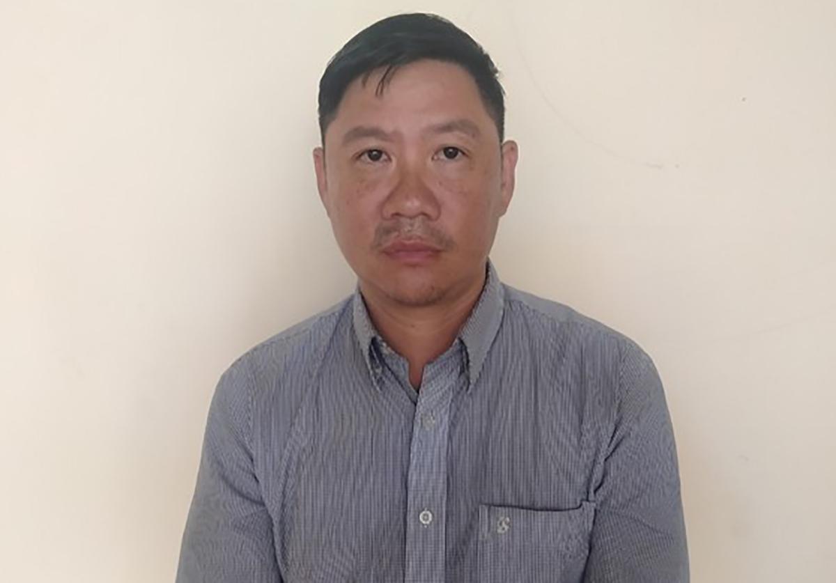 Hưng bị bắt tại cơ quan cảnh sát điều tra. Ảnh: Thái Hà