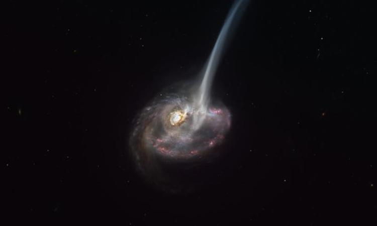 Thiên hà ID2299 phun ra lượng lớn khí sau vụ một vụ va chạm. Ảnh: ESO./M.KORNMESSER.