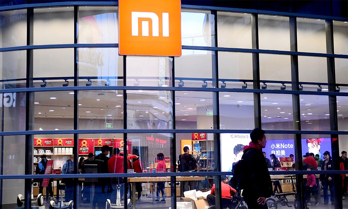 Bên ngoài một cửa hàng của Xiaomi ở thành phố Thẩm Dương, tỉnh Liêu Ninh, Trung Quốc, tháng 4/2018. Ảnh: Reuters.