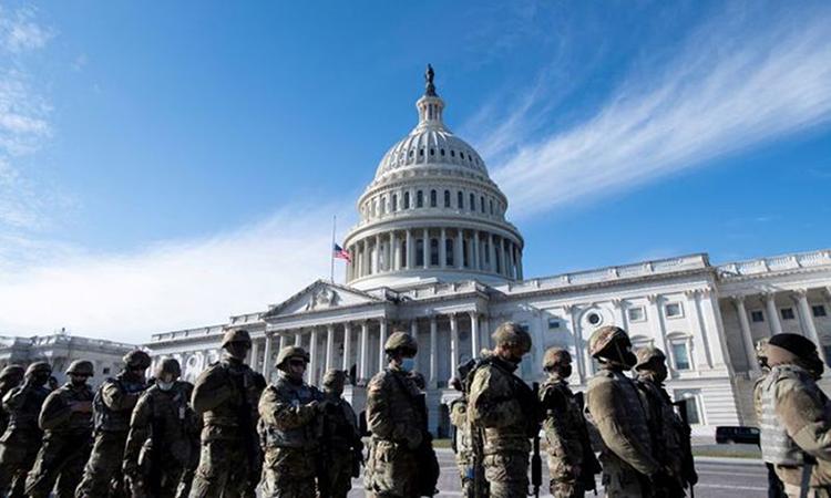 Lực lượng Vệ binh Quốc gia Mỹ tại lễ tổng duyệt lễ nhậm chức của Biden ở thủ đô Washington hôm 18/1. Ảnh: Reuters.